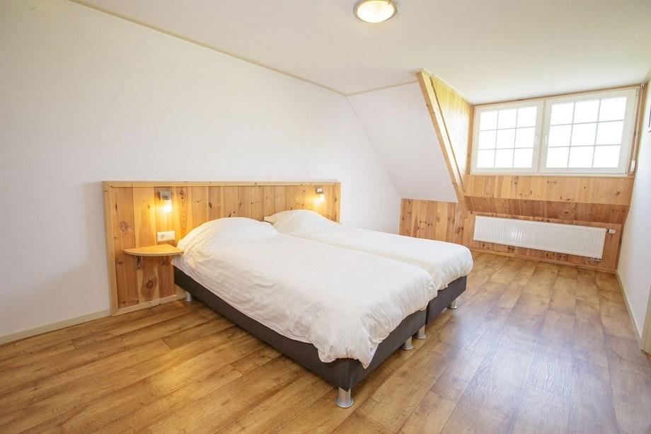 Vakantiehuis met sauna in Gelderland - bed in vakantiewoning Lavendel